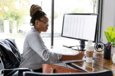Photo of a woman using a computer